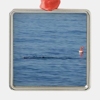 Sea diver in scuba suit swim in water metal ornament