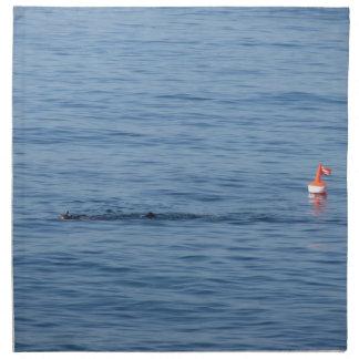 Sea diver in scuba suit swim in water napkin