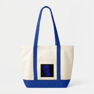 sea horse swims in lights tote bag