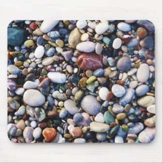 Sea pebbles and stones on a beach close up mouse pad