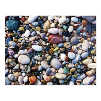 Sea pebbles and stones on a beach close up postcard