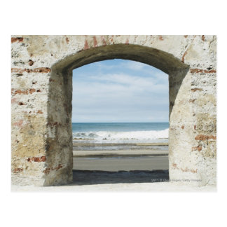 Sea viewed from an archway postcard