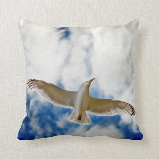 Seagul in flight with blue skies and white cloud, throw pillow