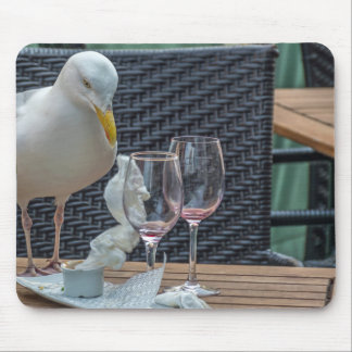 Seagull and empty wine glasses mousepad