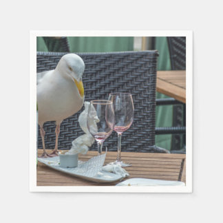 Seagull and empty wine glasses paper napkins