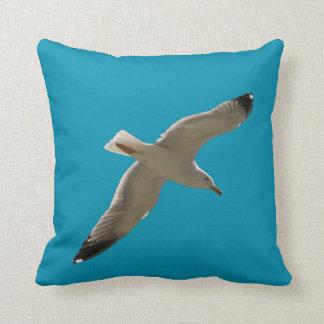 Seagull on a blue sky throw pillow