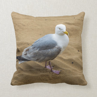 Seagull on a sandy beach throw cushion