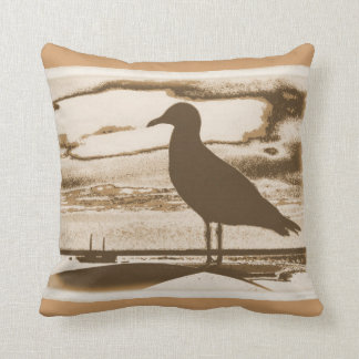 Seagull on the shore throw pillow