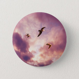 Seagulls flying in a sunset sky 2 inch round button