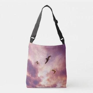 Seagulls flying in a sunset sky crossbody bag