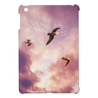 Seagulls flying in a sunset sky iPad mini cases