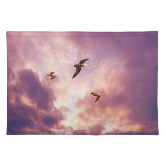 Seagulls flying in a sunset sky placemat