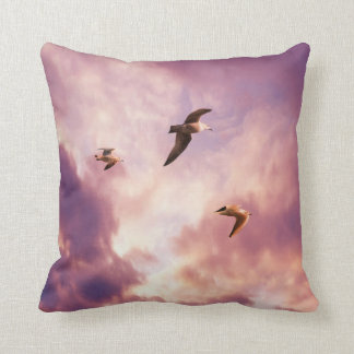 Seagulls flying in a sunset sky throw pillow