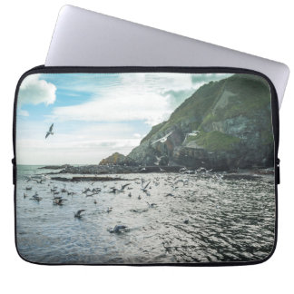 Seagulls flying over the bay laptop sleeve
