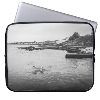 Seagulls flying over the ocean laptop sleeve
