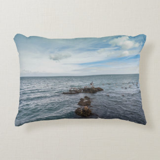 Seagulls flying over the rocks accent pillow