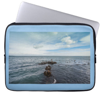 Seagulls flying over the rocks laptop sleeve