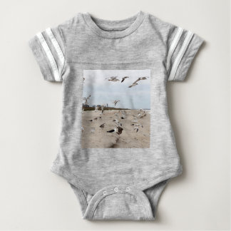 Seagulls Flying, Standing and Eating on the Beach Baby Bodysuit
