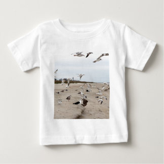 Seagulls Flying, Standing and Eating on the Beach Baby T-Shirt