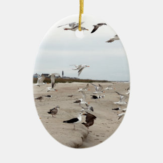 Seagulls Flying, Standing and Eating on the Beach Ceramic Ornament