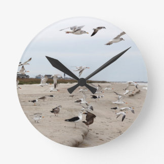 Seagulls Flying, Standing and Eating on the Beach Clocks