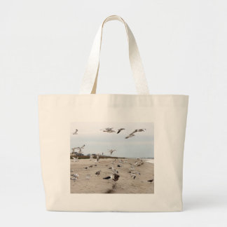 Seagulls Flying, Standing and Eating on the Beach Large Tote Bag