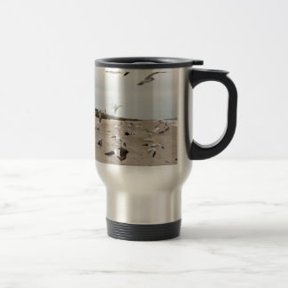 Seagulls Flying, Standing and Eating on the Beach Travel Mug