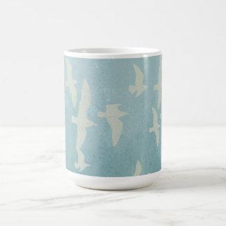 Seagulls in flight on teal blue, flying birds coffee mug