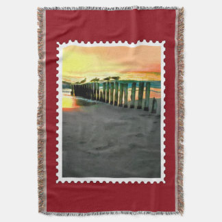 Seagulls on Beach Pilings at Sunset Stamp Throw Blanket
