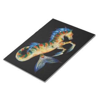 seahorse on black notepad