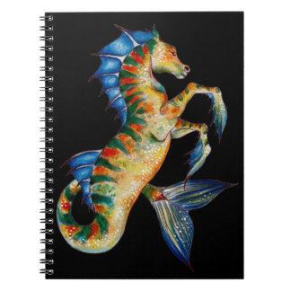 seahorse on black spiral notebook