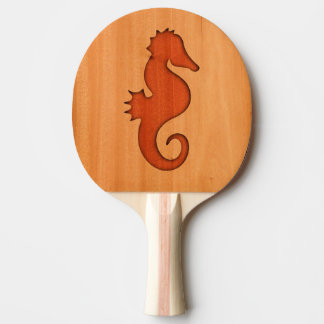 Seahorse silhouette on wood ping pong paddle