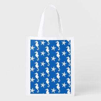 Seahorse & starfish - white on cobalt blue grocery bags