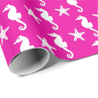 Seahorse & starfish - white on fuchsia pink wrapping paper