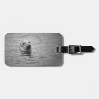 seal photograph luggage tag