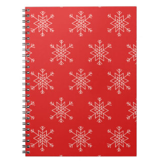 Seamless pattern with snowflakes. Red background. Notebook