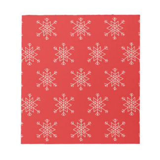 Seamless pattern with snowflakes. Red background. Notepad