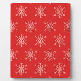 Seamless pattern with snowflakes. Red background. Plaque