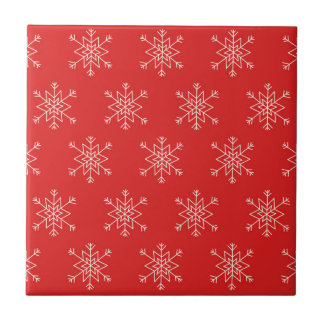 Seamless pattern with snowflakes. Red background. Tile