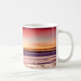 Seascape and pier at sunset, CA Coffee Mug