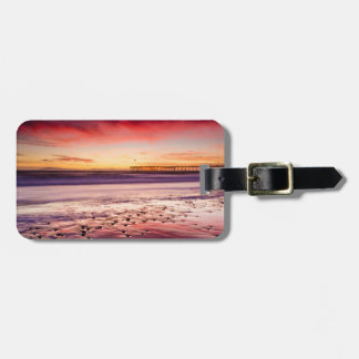 Seascape and pier at sunset, CA Luggage Tag