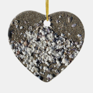 Seashells on sand. Summer beach background Ceramic Heart Ornament