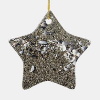 Seashells on sand. Summer beach background Ceramic Star Ornament