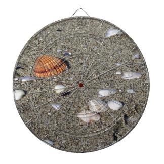 Seashells on sand. Summer beach background Dartboard