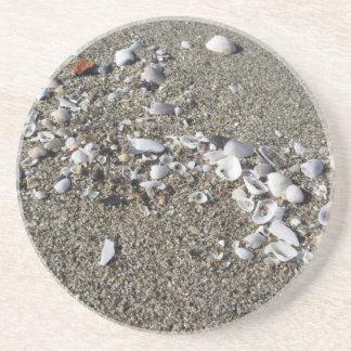Seashells on sand. Summer beach background Drink Coaster