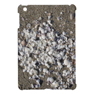 Seashells on sand. Summer beach background iPad Mini Cover