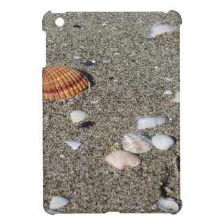 Seashells on sand. Summer beach background iPad Mini Covers