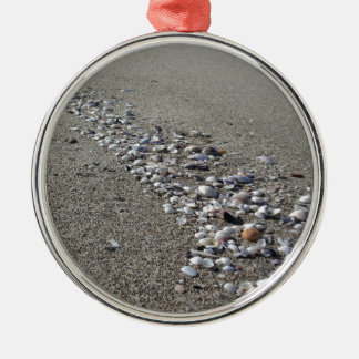 Seashells on sand. Summer beach background Silver-Colored Round Ornament