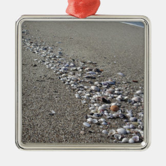 Seashells on sand. Summer beach background Silver-Colored Square Ornament