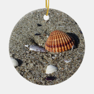 Seashells on sand Summer beach background Top view Ceramic Ornament